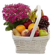 Flowers and a basket of fruit - flowers and bouquets on df.ua